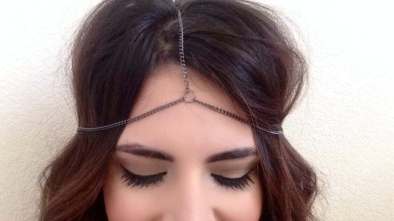 This listing is for a fun and trendy gun metal/silver headpiece. Beautiful and eye-catching accessory. These have been very popular and worn by