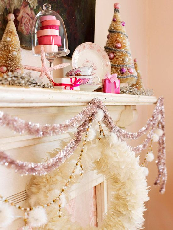 Garland Multiplied:   Instead of one large garland, consider hanging three or four smaller garlands together. Here, two slim lengths of tinsel are swagged at different depths for visibility, then paired with a string of beads (and pom-poms) and a white feather wreath.