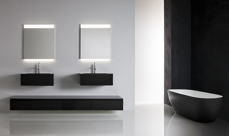 """Crystal is a """"dazzling"""" collection characterised by exquisite glass finishes. Both glamorous and contemporary in appearance, Crystal is available in a choice of transparent or satin glass finishes and offers a projection of 47 cm. Integrated tops in glossy or sand-blasted glass are available in the 38 colour palette choice or else in gloss white Geacril or matt white Tecnoril in two different basin shapes."""