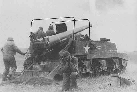 M12 Gun Carriage In Operation In Europe. Cover your ears buddy! BOOM!