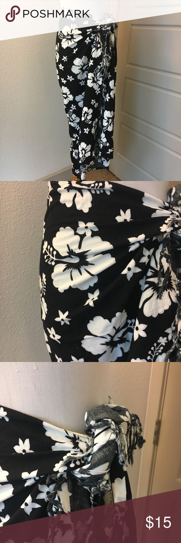Hibiscus Sarong Skirt in Black and White Dillard's Super cute Sarong skirt originally purchased from Dillard's department store. In perfect condition, only worn a handful of times. Great for your next vacation or even a trip to the pool! Has fringed edges. Length is determined by the knot that you tie around your waist. Size is comparable to a small (sizes 4-10 could fit) Feel free to ask questions, I'm happy to help! In Gear Swim Sarongs