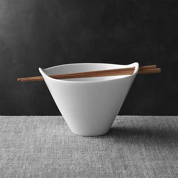 Free Shipping. Shop Kai Noodle Soup Bowl. Modern Asian serving shape in white porcelain rests bamboo chopsticks in the cutout handles.