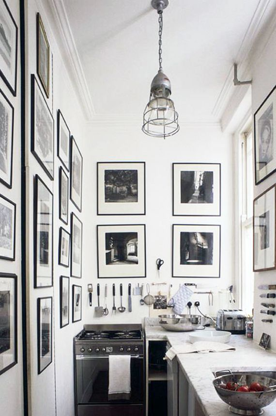 Small space living ... Galley kitchen done well... I like all the pictures on the walls for character