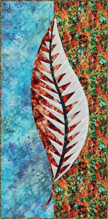 Una hoja de edredón-naranja-verde azulado