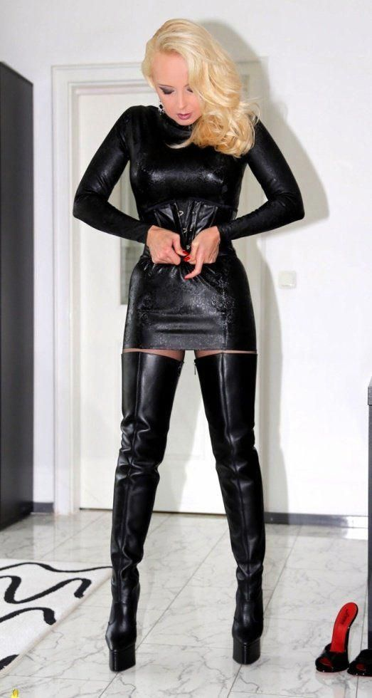 Blonde in a superb black Leather Mini Dress and tantalizing black Leather Crotch…