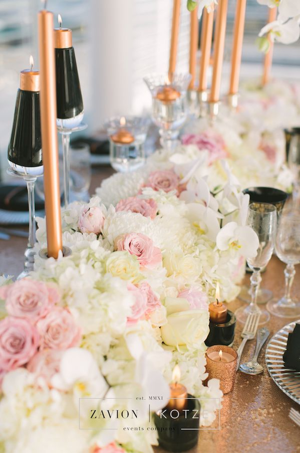 What a gorgeous wedding styled shoot, with gold sequin tables, gold decor décor, white and pink flowers, floral art, having flowers, hanging arrangements, suspended flowers, love, wedding day, wedding flowers, orchids, roses, beautiful wedding flowers, bride, brides dress, black tiffany chairs. , floral runner, flower runner
