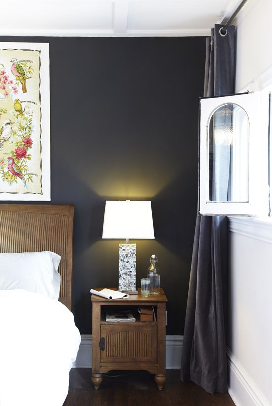 bedroom black wall with timber bedhead and side table