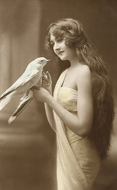 beautiful vintage lady with bird