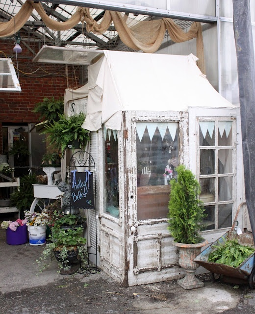 Old doors, widows and shutters turned into a charming outdoor getaway.