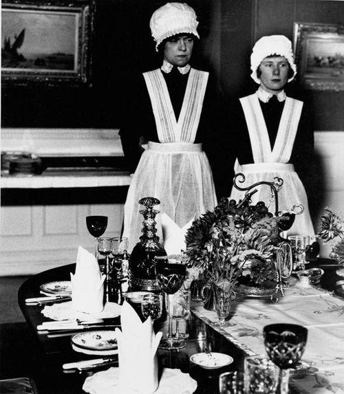 Bill Brandt. Parlourmaid and underparlourmaid ready to serve dinner, Mayfair, 1936