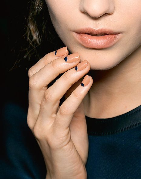 moon manicure in nude and black