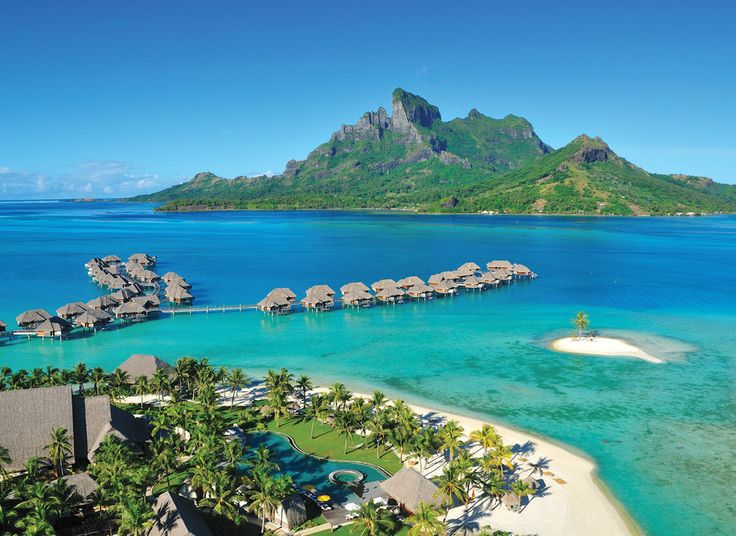 Four Seasons Resort Bora Bora French Polynesia Grounds Island Luxury Overwater Bungalow Scenic views Tropical water sky outdoor mountain Nature landform geographical feature Lake promontory caribbean Sea Coast vacation islet archipelago bay Beach Lagoon Resort cape cove resort town reef shore swimming pond