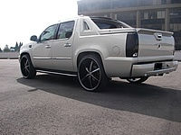 """2007 Cadillac Escalade: 28"""" Velocity wheels, Delinte tires, Eibach 3"""" lowering kit, MBRP exhaust with black tip, Air intake, Power Slot rotors and pads, PIAA 8K HID head lamps, LED Daytime running lights, nighttime running lights, and reverse lights, Blacked out mesh grille, Smoked out head, tail, and brake lamps, as well as smoked out the emblems,  tinted all windows, and a Lock pick iPod interface. AATAC"""
