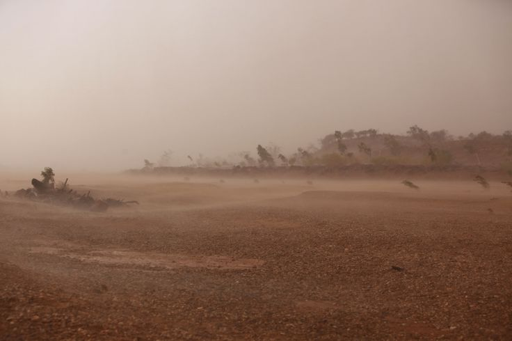f/5 1/200 ISO-100 70mm  Ferocious wind blowing the rain along the river bed. Preceded by yet another dust storm.