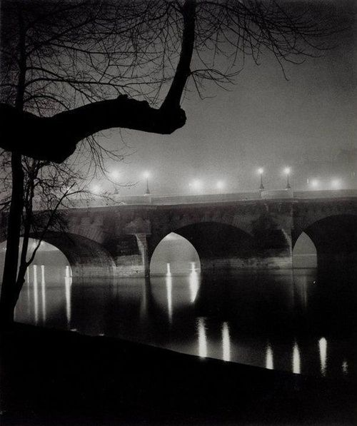 Brassaï, Quai Along the Seine, 1931 In this image I like the contrast between the two atmospheres. The hazy upper half and the clear reflection.