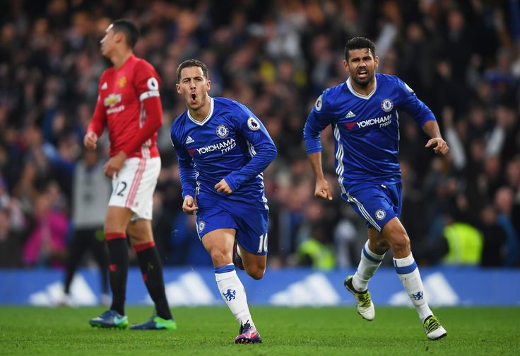 Eden Hazard Photos Photos - Eden Hazard of Chelsea celebrates scoring his sides third goal with Diego Costa of Chelsea during the Premier League match between Chelsea and Manchester United at Stamford Bridge on October 23, 2016 in London, England. - Chelsea v Manchester United - Premier League