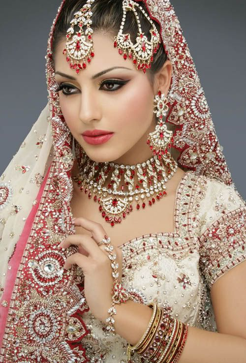 Red Headdress Indian Wedding Dress - http://casualweddingdresses.net/indian-wedding-dresses-step-into-a-world-of-color-bliss-and-refined-elegance-with-the-latest-indian-wedding-dresses/