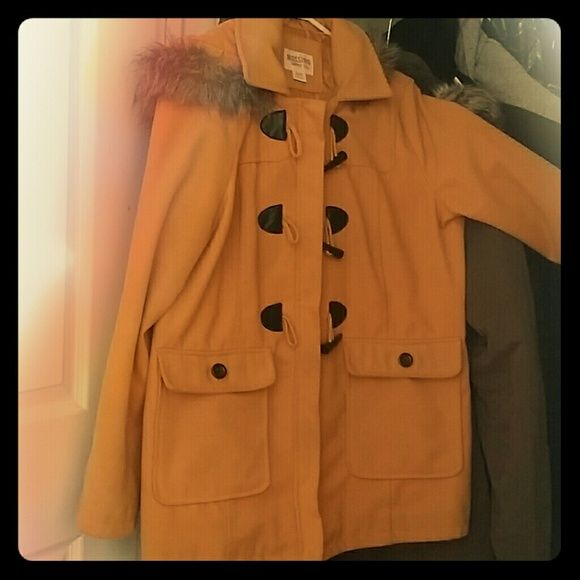 Parka Mossimo brand hooded jacket This is a loved and used mustard color jacket. It has two front pockets and an oversized hood lined with faux fur. It is lined. This jacket kept me warm throughout the harsh NY winter nights! Bought from target. Good for big breasted ladies. Sale or swap! Mossimo Supply Co. Jackets & Coats