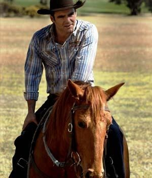 Dustin Clare or better known by this role in Mcleods Daughters as Riley. He rides horses, shoes them, shears sheep, rustles sheep, fixes fences, etc etc... And he says this line which just is so beautiful. Something like 'You've gentled me Jodi.' Am I asking too much?
