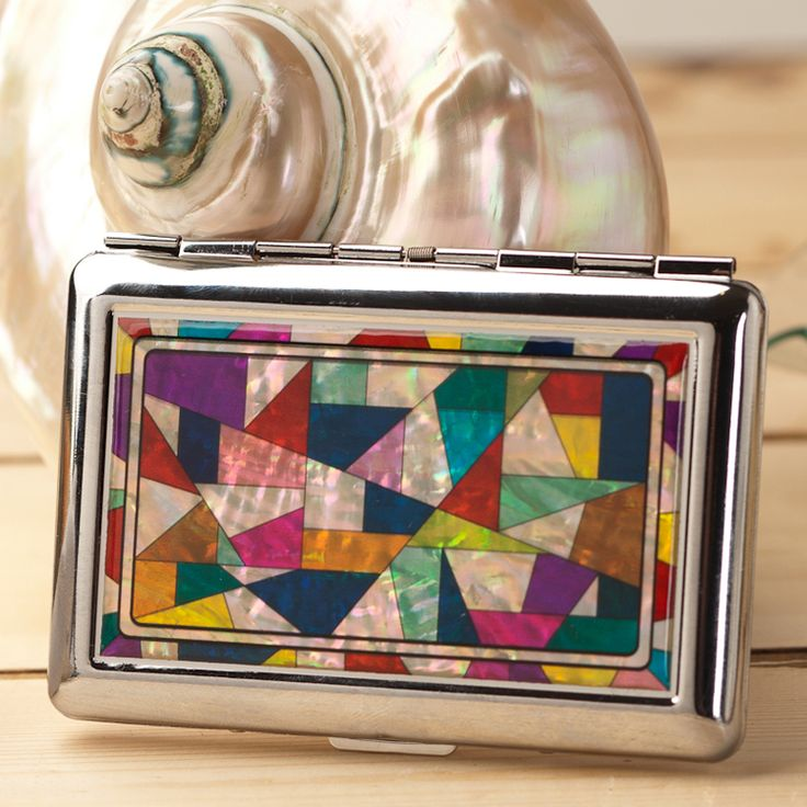 http://www.antiquealive.com/store/detail.asp?idx=4138&CateNum=140&pname=Mother-of-Pearl-Cigarette-Case-with-Patchwork-Design Mother of Pearl Cigarette Case with Patchwork Design