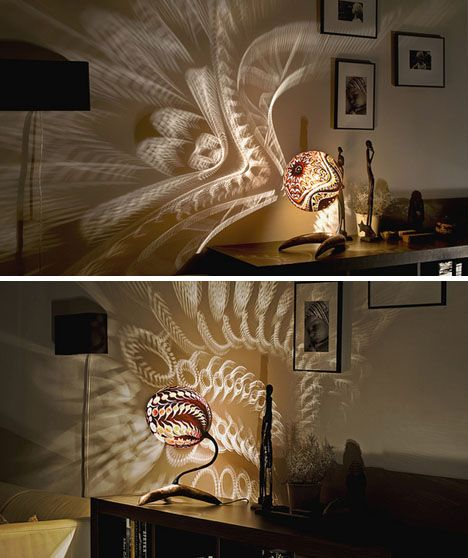 Awesome lamps carved from gourds, check out the patterns they cast on the wall!