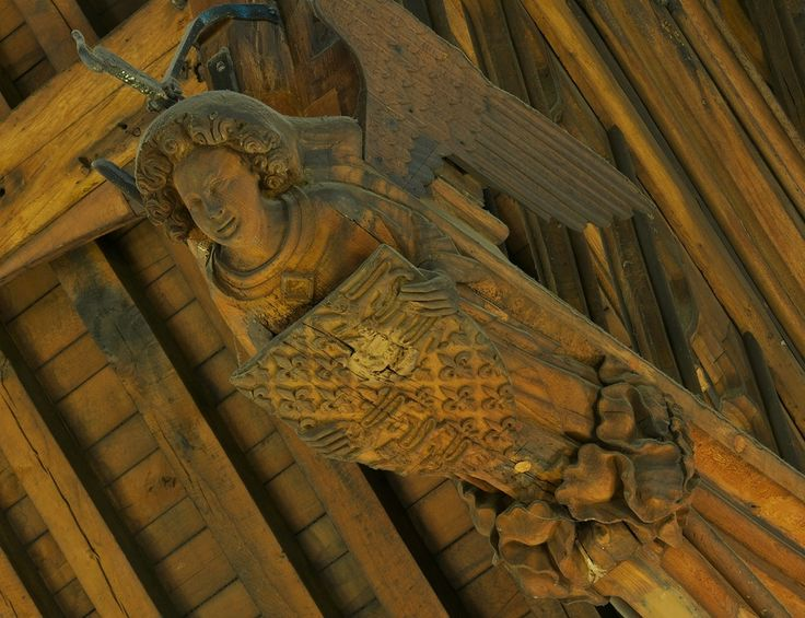 A close up of one of the hammerbeam angels at Westminster: These are undoubtedly the work of talented specialist carvers, known in the Middle Ages as imaginours or imagers. We know the names of four of the men who carved the angels for Westminster Hall, and what they were paid.  Photograph © The Houses of Parliament 2012. Photographer: Michael Rimmer.