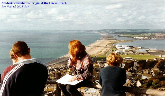 Students at New Ground on the top of Portland consider the origin of the Chesil Beach or Chesil Bank, Dorset