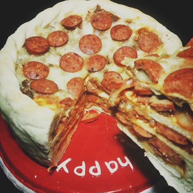 Four-layered pizza cake from @mmkitchen.id. Because if you can get four why stick with one? Location: Jakarta
