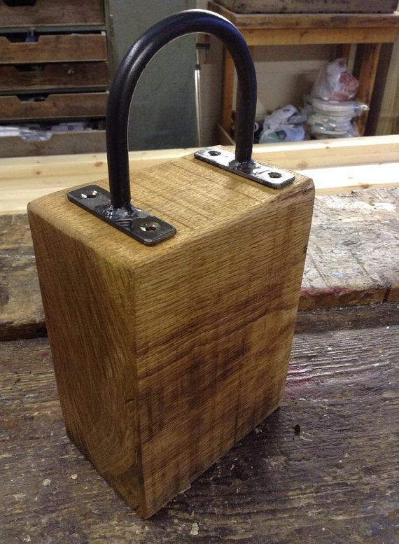 Handmade rustic farmhouse industrial style solid oak door stop with blacksmith made handle on Etsy, $47.20