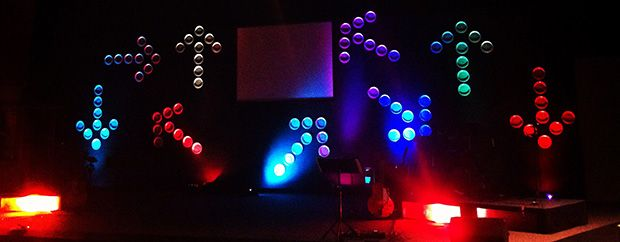 Plate Arrows from West McKinley Church in Fresno, CA. Stage design doesn't have to be a budget buster to make a statement....paper plates and awesome lighting.....very cool!
