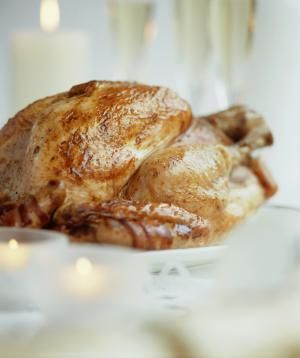 How to Cook Turkey in an Oven Bag (Recipe): Roast turkey on festive table, close up (differential focus)