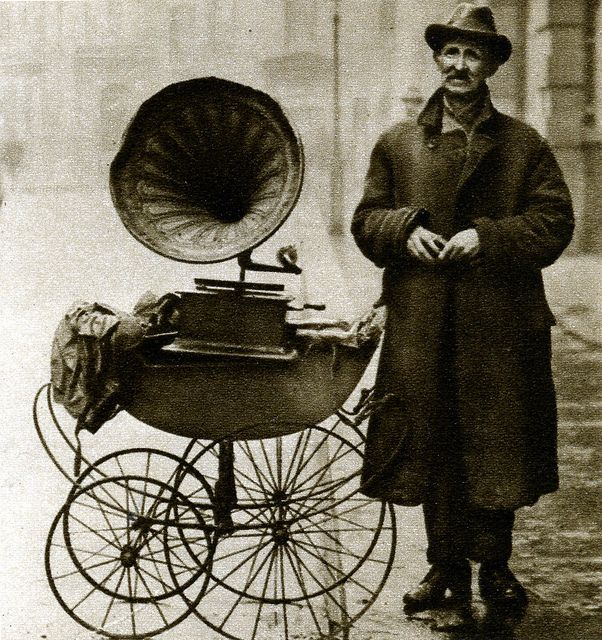 London in the 1920's ~ Street gramophone player ~ This man has been reduced to earning a few coppers in this way ~