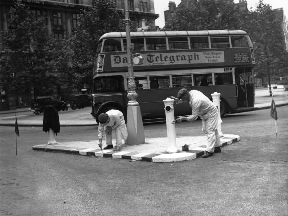 8th August 1939: Painting street bollards white on a traffic island in Sloane Square, London in preparation for a practice blackout prior to WW II. (Photo by Stephenson/Topical Press Agency/Getty Images) #london #war #East_End