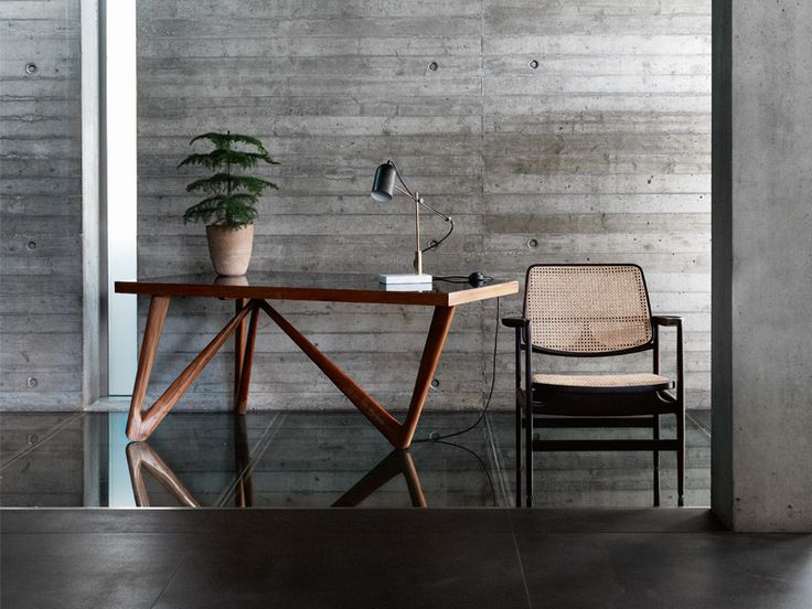 Photograph: Damian Russell. Stylist: Suzanne Stankus. Desk by Jorge Zalszupin in caviuna wood with a glass top, designed for Manchete magazine, £6,800, Da Silva Interiors; Oscar chair by Sergio Rodrigues, £2,400, Espasso; Catherine table lamp, £560, The Conran Shop; Araucaria excelsa plant, £20, and terracotta pot, £20, both West Six Garden Centre