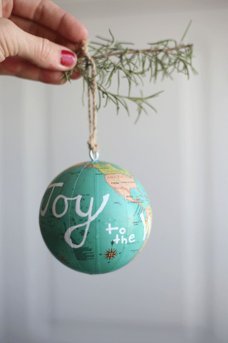 "Add hand lettering to a mini globe for a ""Joy to the World"" DIY ornament for your Christmas tree."