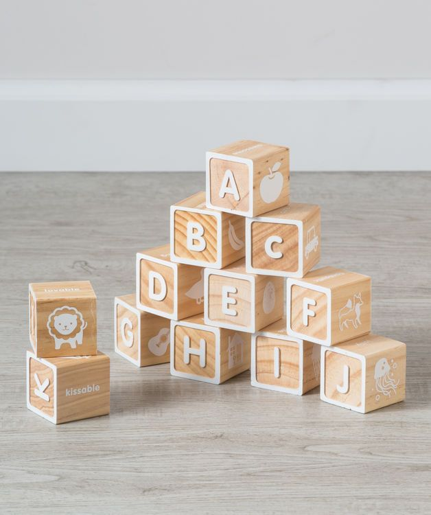 Build a wall of words and make nurseries great again! This set is our take on the vintage wooden block toy set from days past. It looks wonderful as nursery decor but it's even more fun to stack and watch them tumble! These natural pine blocks will form roads, bridges, towers and skyscrapers, anything your little can imagine. This wooden block set will become a big favorite for your little in no time. Available for a very limited time on Hallmark Baby this fall and holiday season.