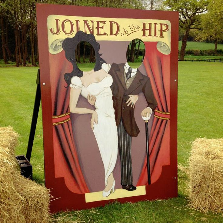 Free standing hand painted head in hole board. Classic wedding 'joined at the hip' design. Hire this for £45.