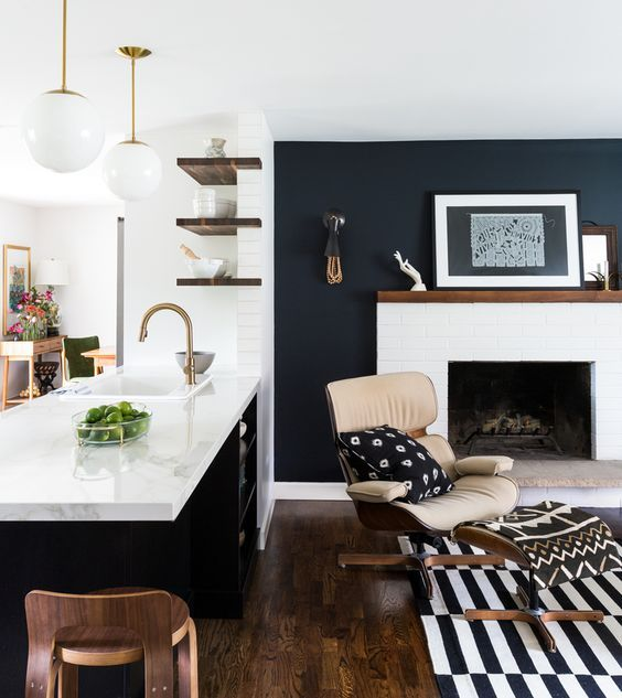 Bellevue Mid-Century Renovation  by brio interior design. Photograph by Haris Kenjar.  LOOOVE the almost black feature wall with white brick fireplace.  Quartz countertop and black island.