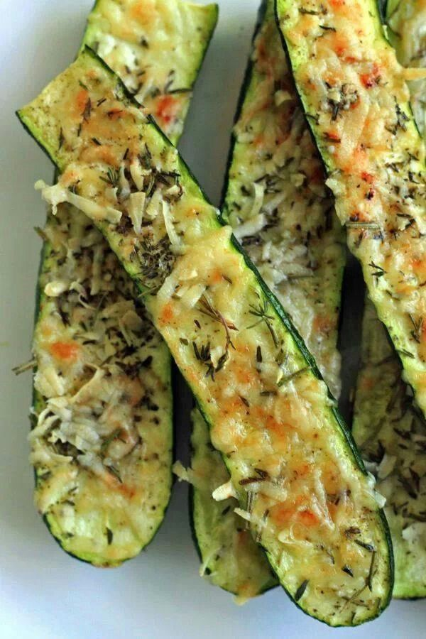 Parmesan zucchini bites: 4 medium zucchini cut in half. 1/2 cup grated parmesan cheese 1 to 2 tablespoons minced rosemary and thyme.  Smidgen of olive oil Salt and pepper to taste PREHEAT OVEN TO 350 Place zucchini on foil lined baking sheet Lightly brush zucchini with oil Mix cheese and herbs together Spread onto zucchini with salt and pepper Bake 15 minutes and then broil for 3 to 5 minutes until cheese is crispy and browned.
