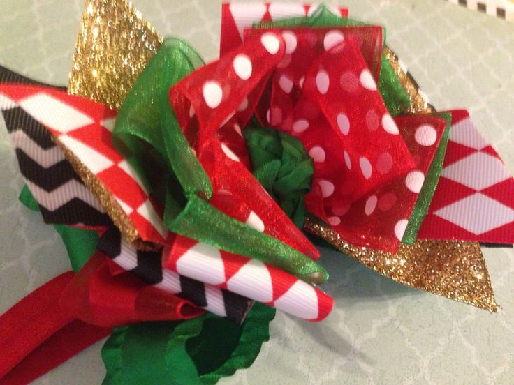 Girls fancy Christmas bow with argyle, gold, polka dots and sparkle on double ruffle