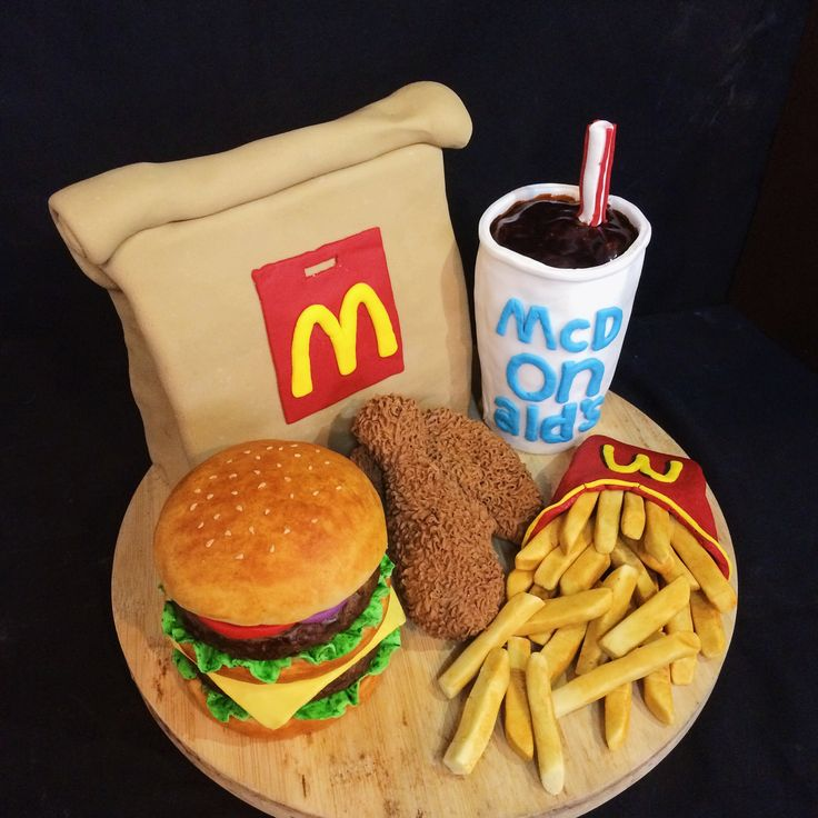 cake decoration fondant. Theme mcdonalds. burger, fried chicken, french fries, coca cola, paper bag.