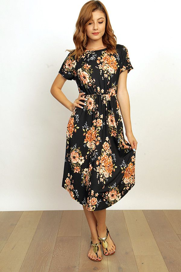 This Black Floral Midi Is Made Of Comfy Polyester And