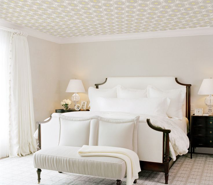 All-white and cream traditional bedroom with wallpaper on the ceiling