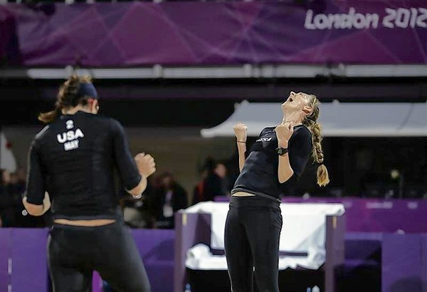 Misty May-Treanor and Kerri Walsh Jennings of the U.S. celebrate after defeating Austria's Doris and Stefanie Schwaiger during their women's preliminary round beach volleyball match at Horse Guards Parade during the London 2012 Olympic Games