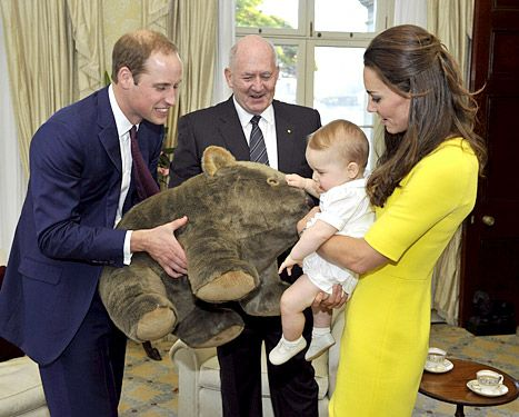 Prince George (with parents Prince William and Kate Middleton)  receives a gift from the Governor-General Sir Peter Cosgrove at Admiralty House, on April 16, 2014 in Sydney, Australia.