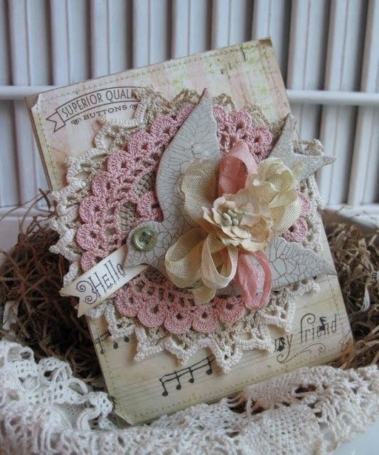 """""""Hello"""" .. says the little bird. I adore vintage doilies so them being used on a card like this would make this one a keeper for me. Absolutely wonderful card. I love it."""