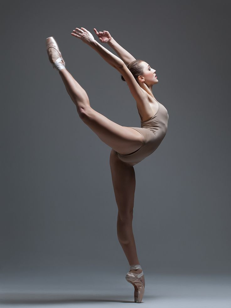 the dancer - young beautiful dancer posing on a studio background