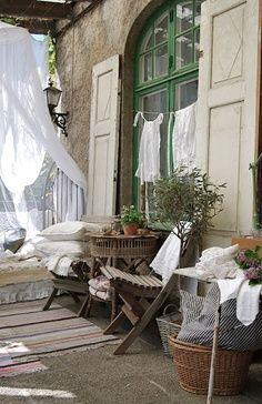 beautiful window, shutters, verandah. - just needs timber deck instead!