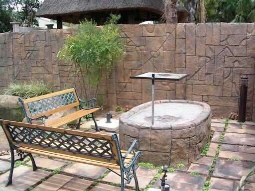 Artificial rock braai with rock walling and koi pond by Designer Gardens Landscaping www.designergardenlandscaping.co.za