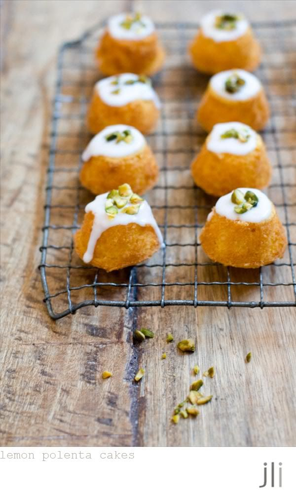 little lemon polenta cakes - love this idea but would use Leanne's recipe for lemon syrup cake and see if i can find a petit four pan so that they are a bit more interesting. purple in the icing & a flower or sprinkles or sanding sugar or something